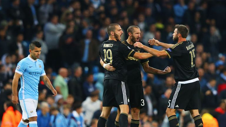 Juventus celebrate victory in their Champions League clash with Man City