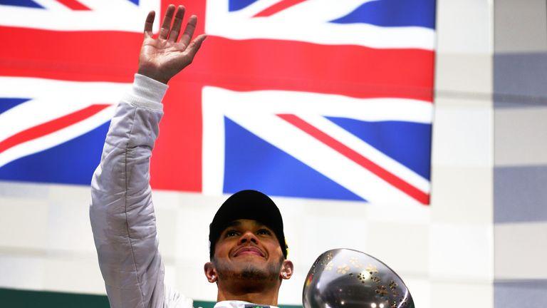 Lewis Hamilton celebrates victory in 2014