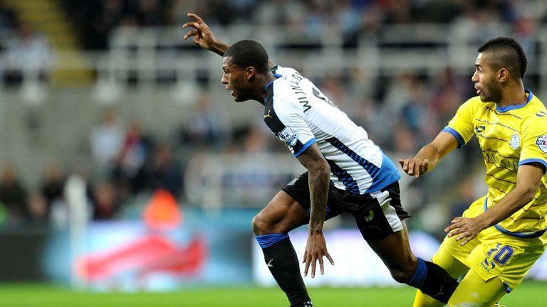 Newcastle United's Georginio Wijnaldum vies with Sheffield Wednesday's Lewis McGugan