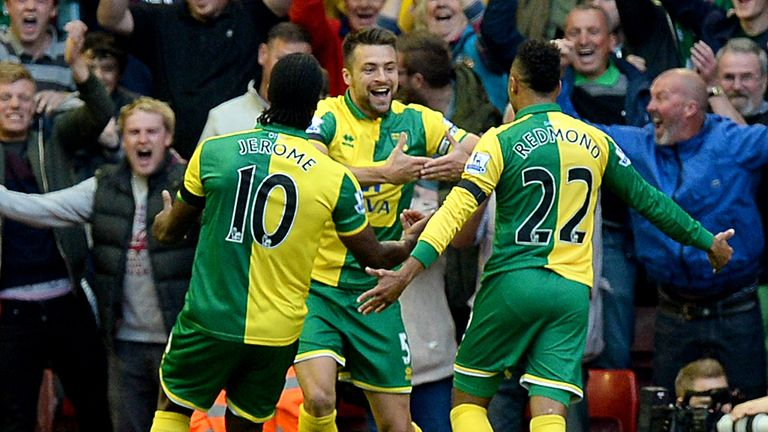 Norwich City's Russell Martin celebrates his equaliser against Liverpool