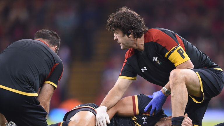 Wales' Rhys Webb lies on the ground injured during the World Cup warm up match v Italy