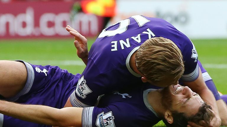 Harry Kane celebrates with Ryan Mason, as he lies injured after scoring the only goal in the match