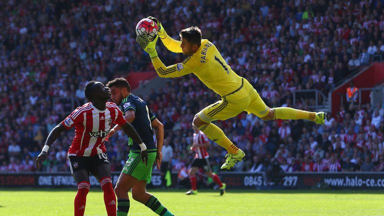 Lukasz Fabianski makes a save with Southampton forward Sadio Mane waiting to pounce