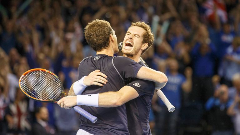 Andy and Jamie Murray celebrate winning the pivtoal doubles rubber against Australia