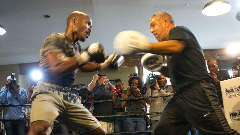 Timothy Bradley (L) and trainer Joel Diaz (R) have gone separate ways
