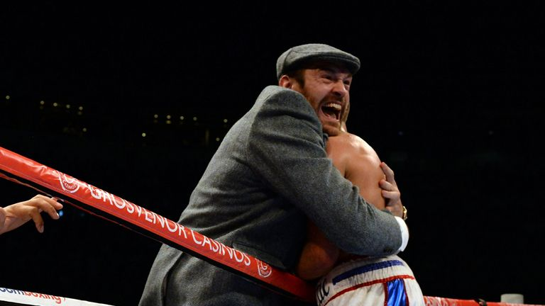 Tyson Fury (L) embraces Isaac Lowe after his impressive title win