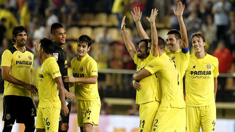 Villarreal's players celebrate their victory over Atletico Madrid