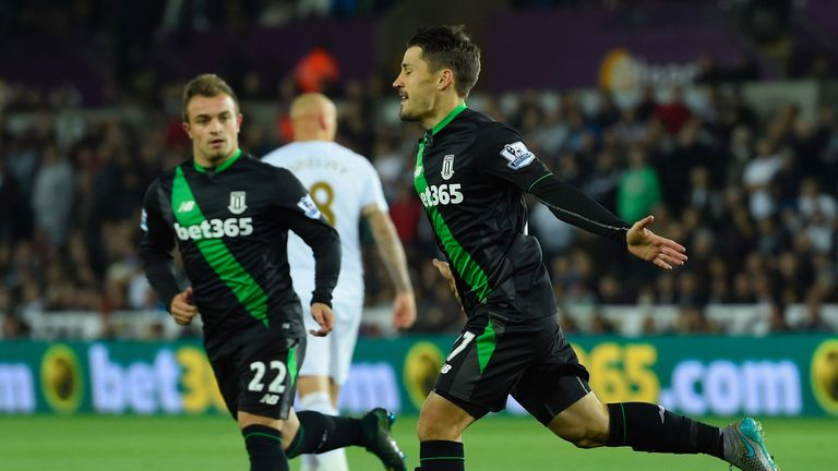 Bojan (right) celebrates after scoring from the penalty spot