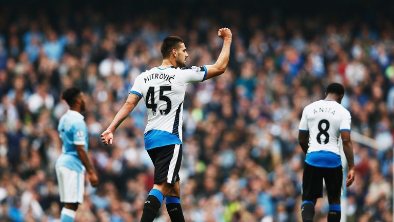 Aleksandar Mitrovic celebrates after putting Newcastle 1-0 up