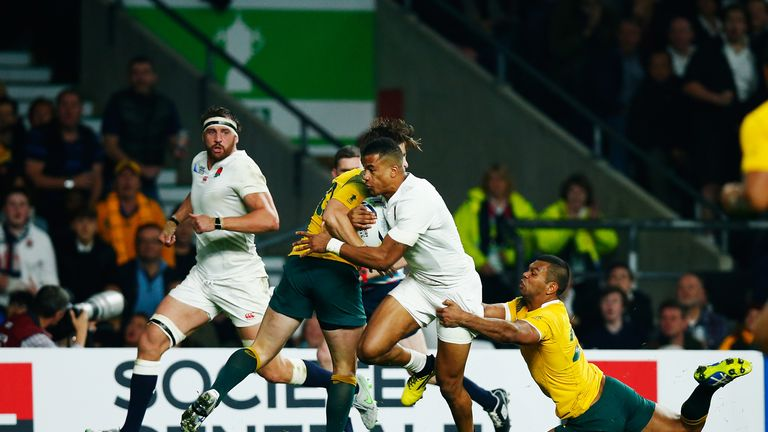 Anthony Watson (middle) scored a try to raise hopes of an England comeback