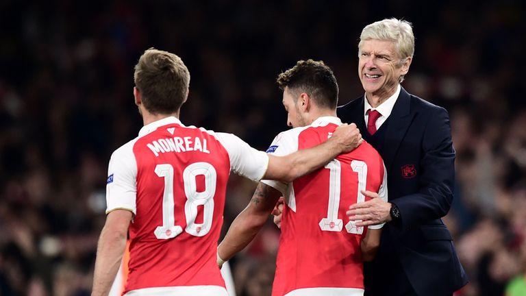 Arsene Wenger (right) celebrates with Mesut Ozil (middle)