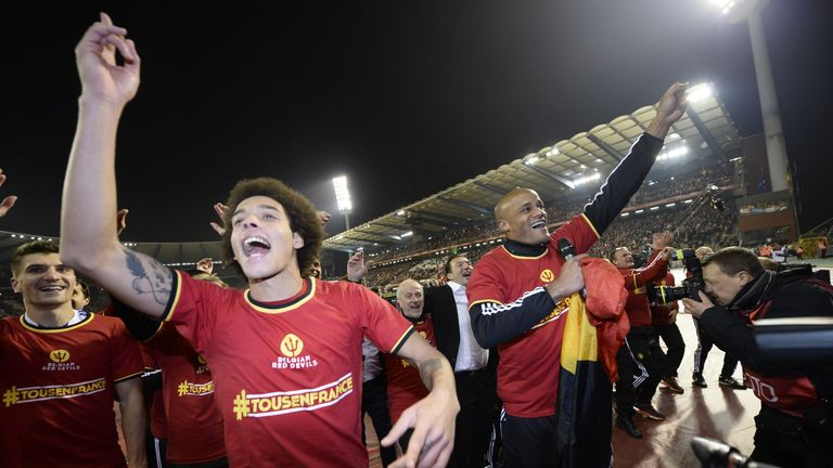 Vincent Kompany (right) celebrated Euro 2016 qualification after playing an hour against Israel