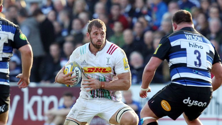 Harlequins Chris Robshaw is confronted by Bath's David Wilson