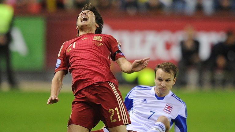 David Silva injured his ankle after this challenge from Luxembourg's Lars Gerson