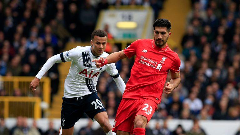 Tottenham's Dele Alli looks to catch Emre Can