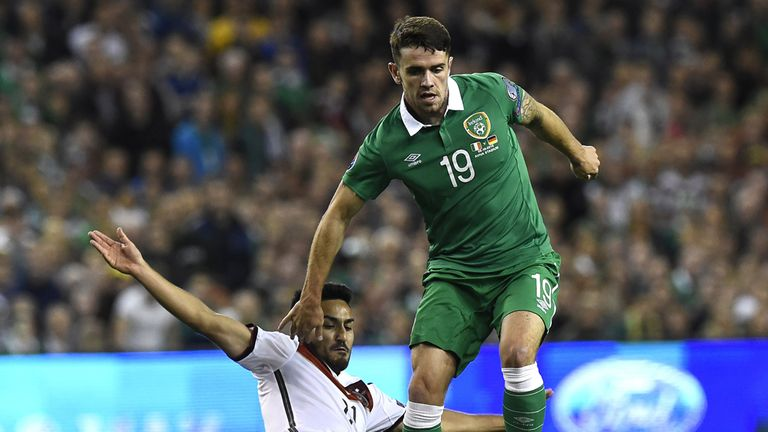 Ilkay Gundogan tackles Robbie Brady in the first half in Dublin