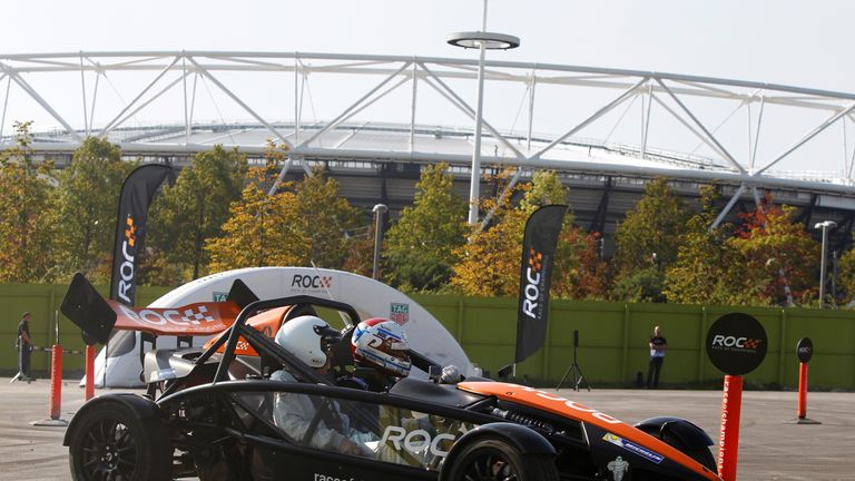 Jason Plato drives an Ariel Atom in the shadow of the Olympic Stadium