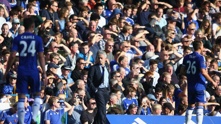 Chelsea manager Jose Mourinho (centre) watches from the sidelines