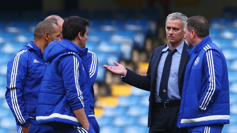 Chelsea manager Jose Mourinho debriefs his staff on the pitch after their team's 3-1 defeat to Liverpool