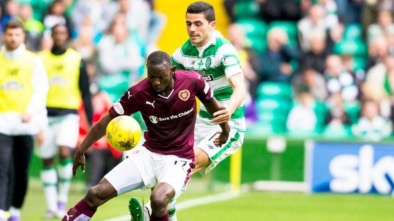 Juwon Oshaniwa of Hearts holds off Celtic's Tom Rogic
