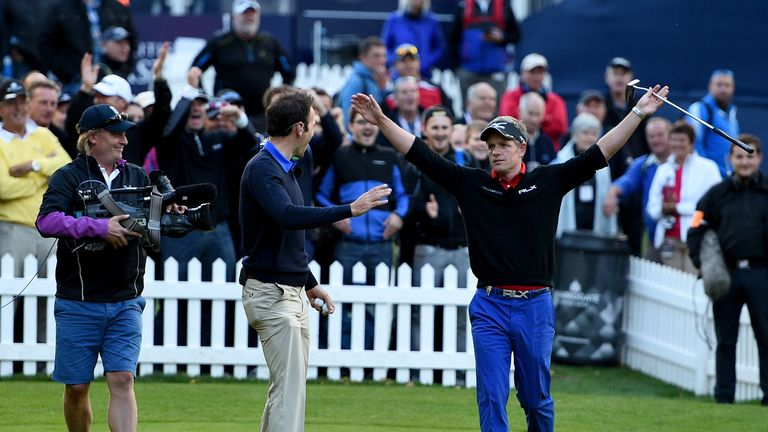 Luke Donald celebrates with Nick after nailing a huge putt in Friday's Masterclass