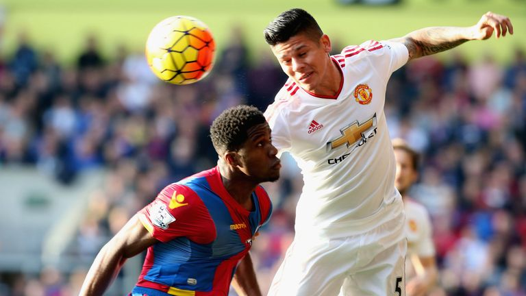 Rojo in action with Crystal Palace's Wilfried Zaha at Selhurst Park