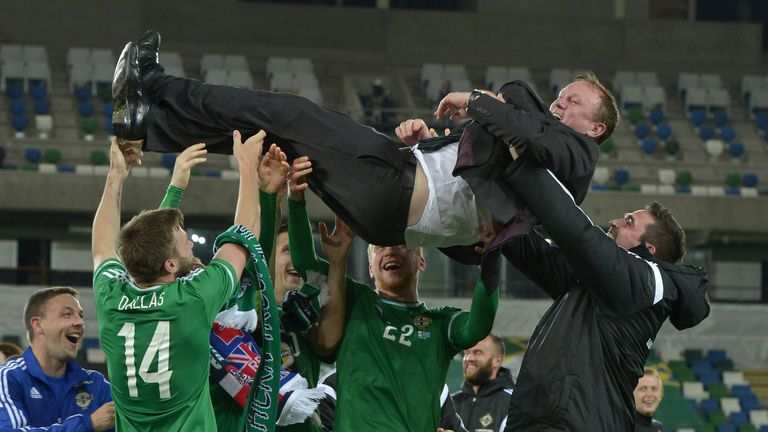 Northern Ireland manager Michael O'Neill enjoys the post-match celebrations in Belfast