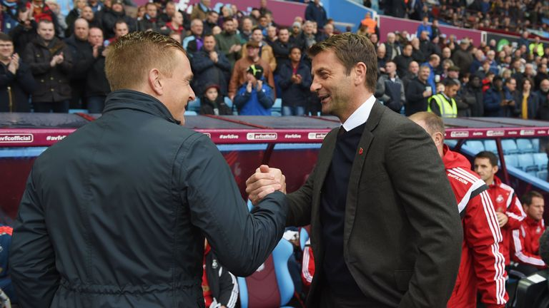 Sherwood greets Swansea boss Garry Monk in what turned out to be his final game