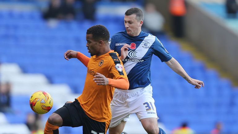 Birmingham City's Paul Caddis and Wolverhampton Wanderers' Nathan Byrne (left) battle for the ball
