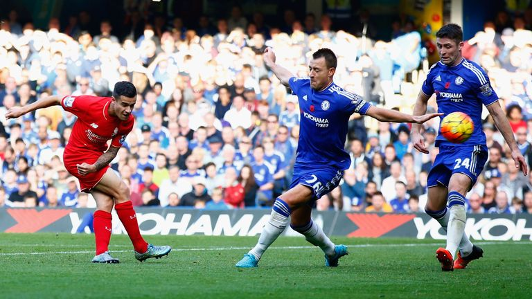 Philippe Coutinho (left) scores his second of the game to put Liverpool 2-1 up against Chelsea