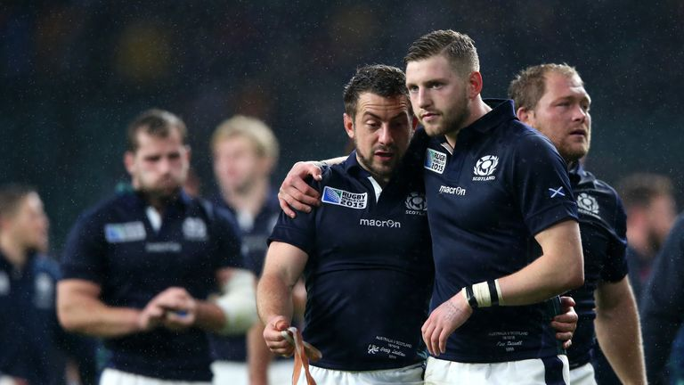 Greig Laidlaw (left) and Finn Russell are dejected as Scotland suffer World Cup heartbreak against Australia