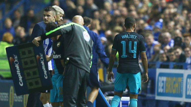 First half substitute Theo Walcott of Arsenal comes off injured