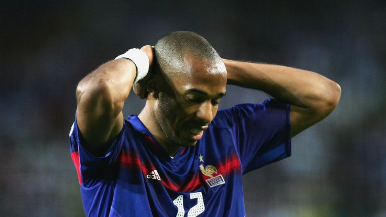 Thierry Henry holds his head as France are beaten by Greece at Euro 2004