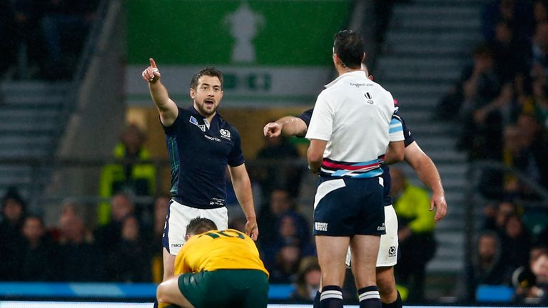 Greig Laidlaw talks to referee Craig Joubert after he awarded Australia a late penalty