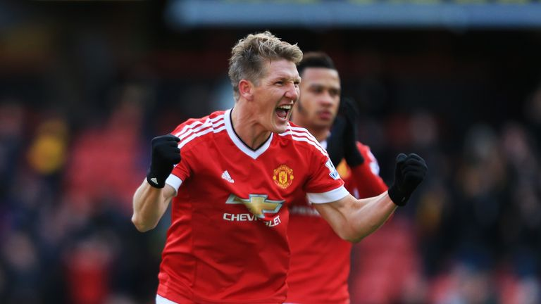 Bastian Schweinsteiger celebrates his team's second goal, one he forced with a shot in stoppage time