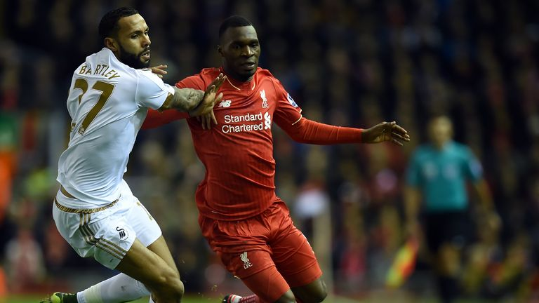 Liverpool striker Christian Benteke vies with Swansea's Kyle Bartley (left)