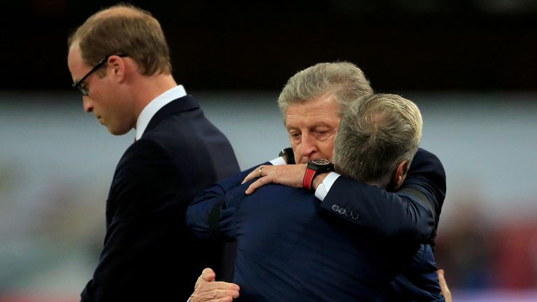 England manager Roy Hodgson embraces France manager Didier Deschamps