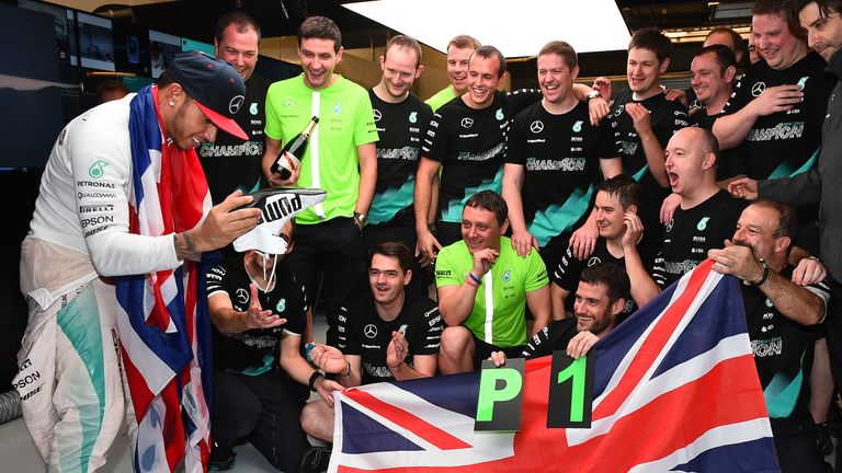Just done it: Lewis Hamilton celebrates with his pit crew after clinching his third world title - Picture by Keith Sutton, Sutton Images