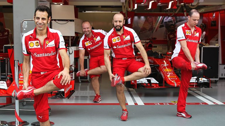 On the stretch: Ferrari mechanics warm up for their pitstop practice ahead of the Singapore GP - Picture by Mirko Stange, Sutton Images