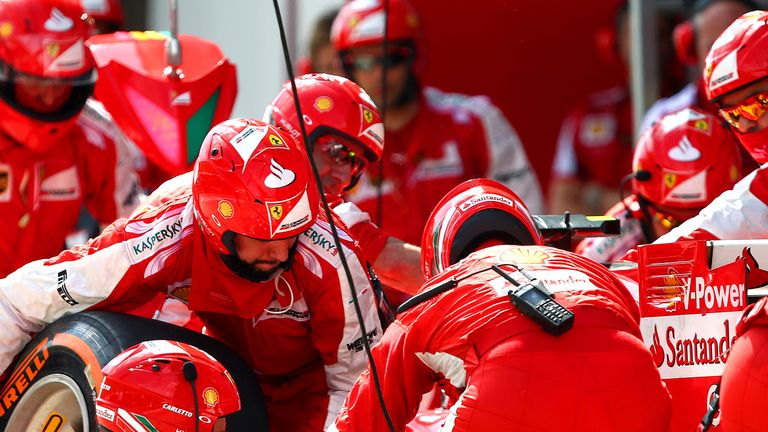 The men in red: Kimi Raikkonen's pit crew execute a change of tyres in Malaysia - Picture by Mark Thompson, Getty Images