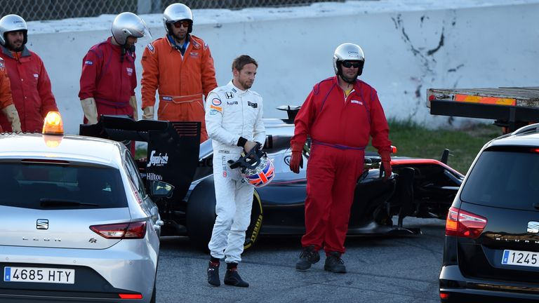Starting as they would go on: Jenson Button is given a lift back to the pits after his McLaren car breaks down in testing - Picture by Sutton Images