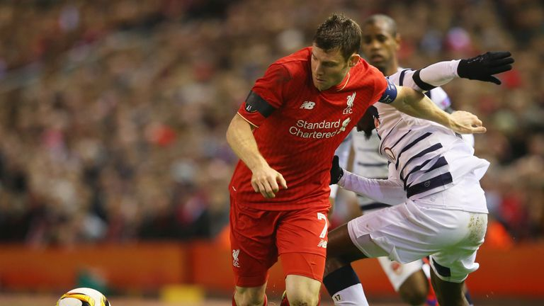 James Milner holds off Andre Biyogo Poko