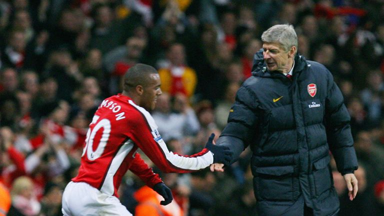 Simpson is congratulated by Arsene Wenger after scoring against Wigan