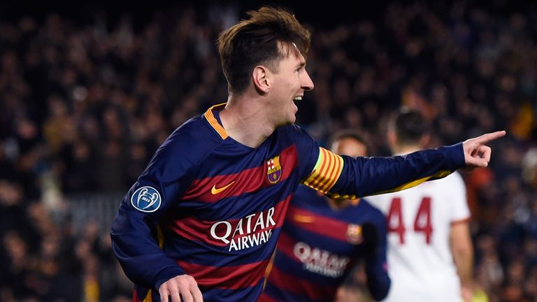 Lionel Messi celebrates scoring his second goal in Barcelona's midweek win over Roma