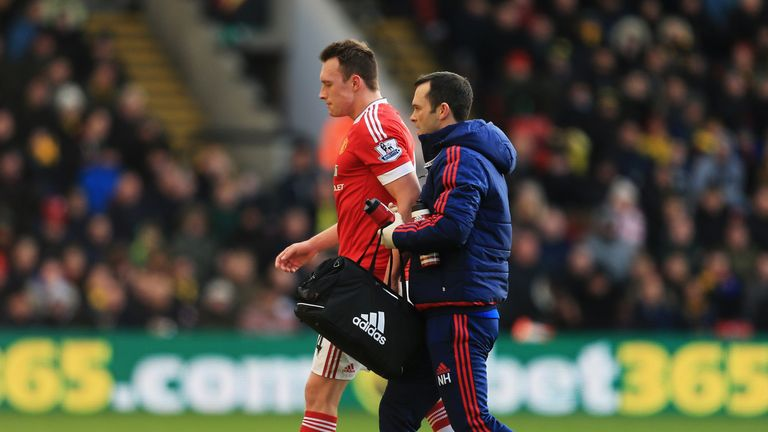 Phil Jones walks of the pitch at Vicarage Road