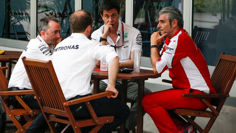 Ferrari team boss Maurizio Arrivabene in discussions with his Mercedes counterparts at the Malaysia GP