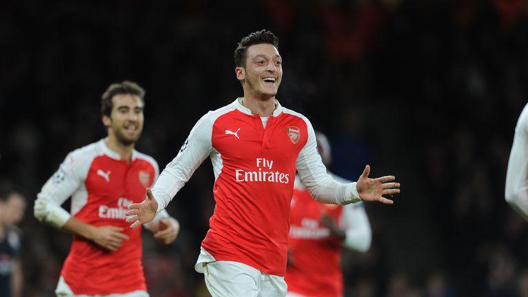 Mesut Ozil celebrates  Arsenal's first goal against Dinamo Zagreb