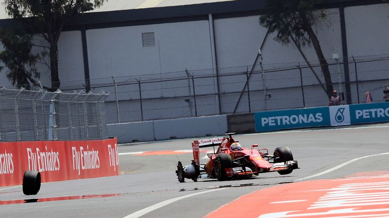 Vettel suffered a puncture after a first-lap collision with Daniel Ricciardo