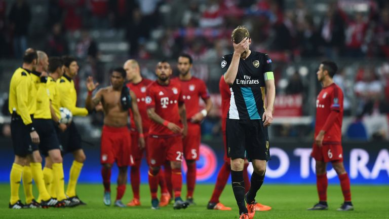 A dejected Per Mertesacker following Arsenal's Champions League defeat in Munich