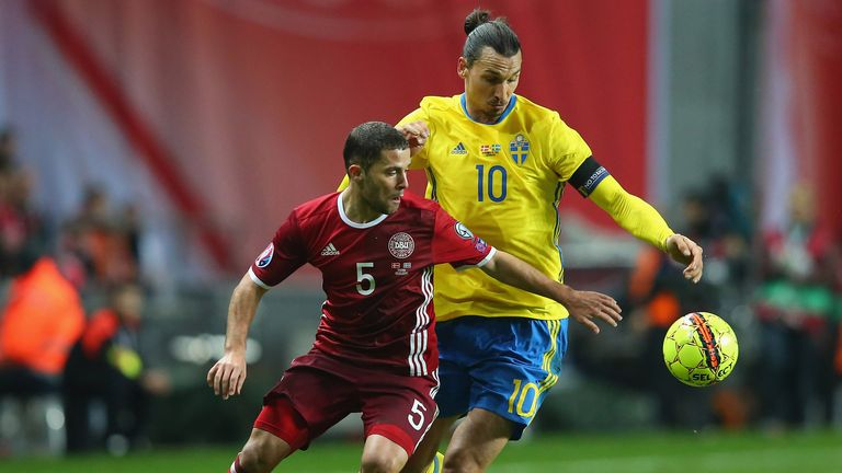 Riza Durmisi of Denmark and Zlatan Ibrahimovic of Sweden compete for the ball